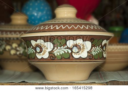 Ceramic bowl with a lid ornamented national pattern.