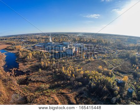 Aerial view of the factory and the village Maksatikha. Shooting from height of the bird's flight. Maksatikhinsky District Tver Region.