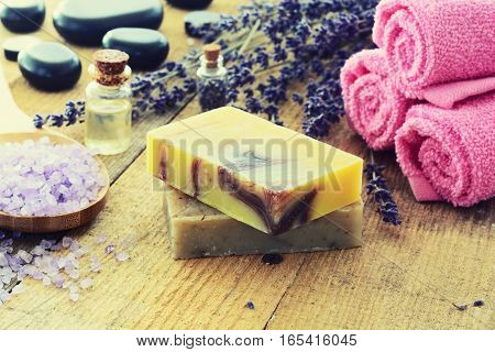 Lavender soap and salt on rustic wooden board