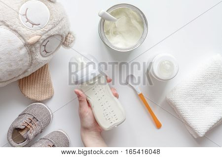 preparation of mixture baby feeding on white background top view.