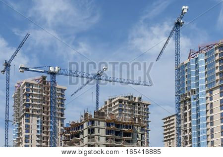The complex is under construction high-rise buildings and a group of tower cranes