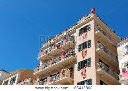 CORFU GREECE - APRIL 30, 2016: Corfians throw clay pots from windows and balconies on Holy Saturday to celebrate the Resurrection of Christ. Easter pot smashing.