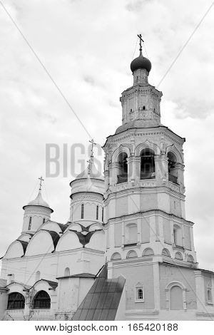 Spassky Cathedral with bell tower in Saviour Priluki Monastery by cloud day near Vologda Russia. Black and white.