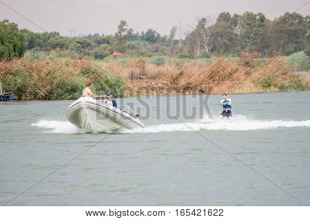 RITCHIE SOUTH AFRICA - DECEMBER 30 2016: An unidentified skier being towed by a boat on the Riet River (reed river) at Ritchie a small town in the Northern Cape Province