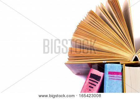 Open book hardback books isolated on white background. Back to school. Copy space for text