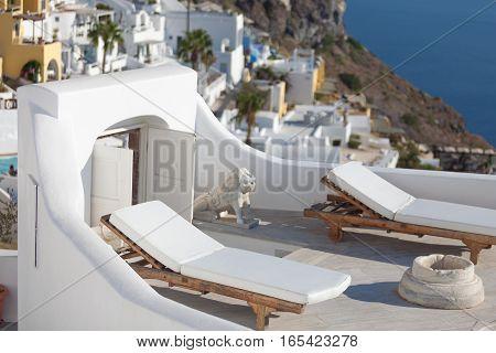 Sunbeds on the terrace of a hotel. Oia Santorini island Greece.