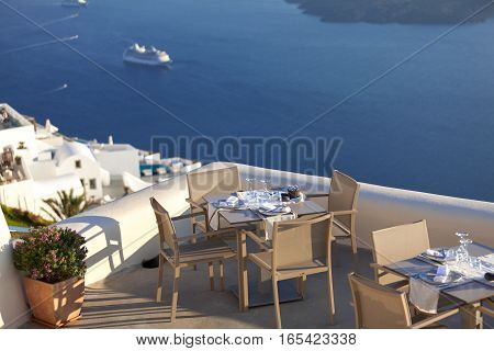 Beautiful restaurant terrace with sea view. Oia Santorini island Greece.