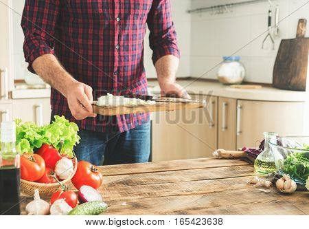 Ingredients for cooking healthy food on a wooden table with place for your product in a home kitchen.