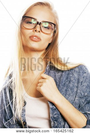 young pretty girl teenager in glasses on white isolated blond hair modern hipster close up