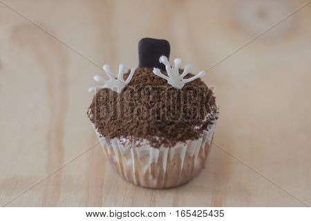 Zombie cupcake coming out of the grave
