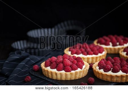 Delicious Raspberry Mini Tarts On Dark Background
