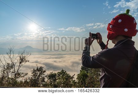 Man with red hat take a beautiful mist and sun shine