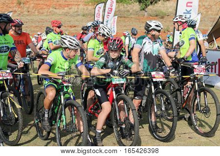 Old And Young Riders At Start Of Marathon Mountain Bike Race