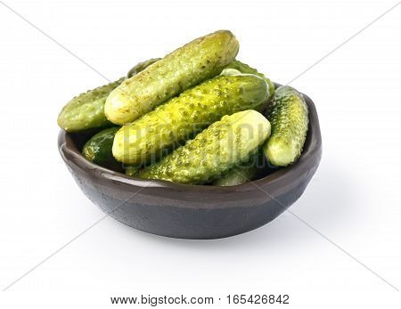 Pickled cucumbers in bowl isolated on white with clipping path