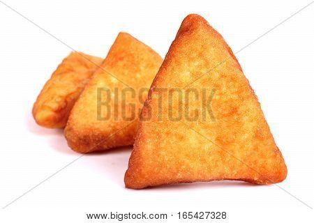 Three triangle Pirozhki isolated over white background