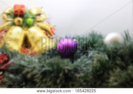 Blurred Christmas decoration background. Blurred Christmas background. Blurred Christmas background with ball and bell. Blurred Abstract christmas background