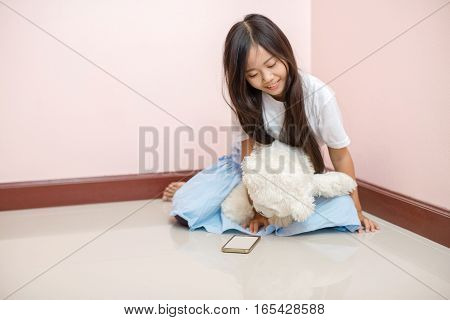 Child Little Girl Asian Thai Nationality With White Toy Teddy Bear Over Pink Wall Background Sitting