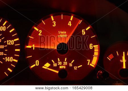 Motor rev long exposure of tachometer on dash