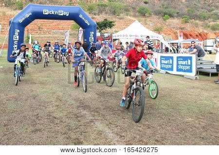 Old And Young Riders At Start Of Fun Mountain Bike Race