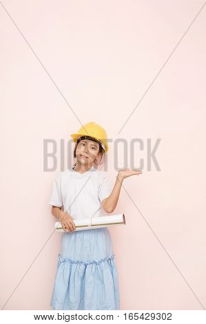 Smile Little Girl As Architect Engineer Dream To Future, Smile And Shows Welcome Hand.