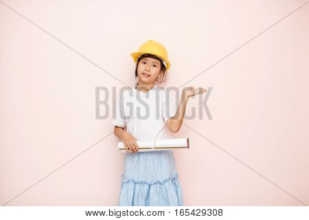 Smile Little Girl As Architect Engineer Dream To Future Shows Hand Welcome.