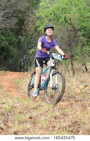 Young Girl Enjoying Outdoors Ride At Mountain Bike Race