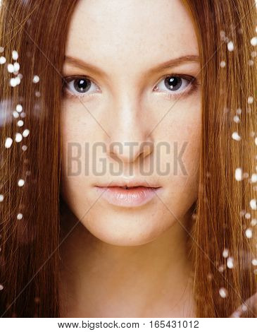 red hair woman with drops on her face, sad at windows, rain outside