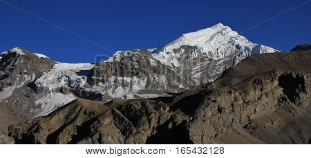 Chulu West high mountain in the Annapurna Conservation Area. Azure blue autumn sky.