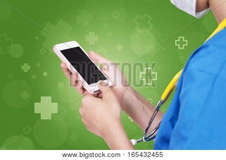 Female Nurse Using Pink Mobile Dark Screen Over Abstract Green With Hospital Icon Background.