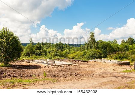 View of construction site and house foundation in preparation process in summertime