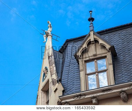 Garret Roof With Sculptures And Windows, Riga, Latvia.