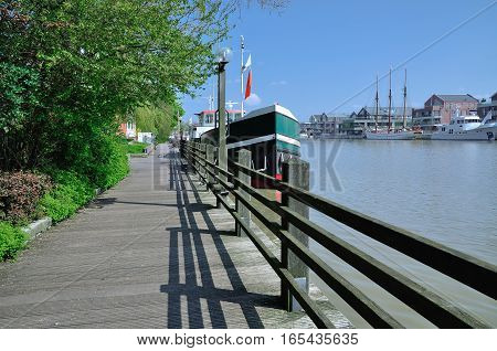 Promenade in Village of Leer at Leda River in East Frisia,North Sea,lower saxony,Germany