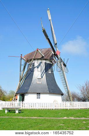 Windmill of Werdum near Neuharlingersiel in East Frisia at North Sea,lower Saxony,Germany