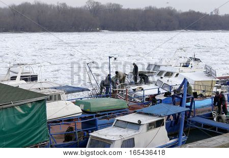 Belgrade, Serbia. January 16Th 2017: People Take Out Trapped Boat From The Frozen Danube River In Be