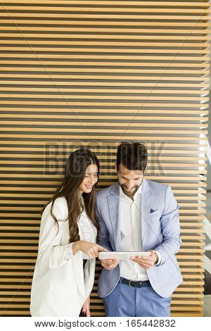 Business Couple Using Tablet