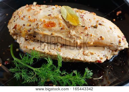 Roasted chicken breast with spices on wooden background