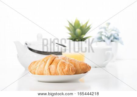 Delicate croissants presented in a breakfast type setting.