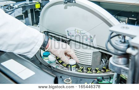 Close Up Scientist Doing Chemical Test In Modern Laboratory. Selective Focus