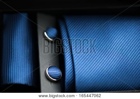 attributes of men's fashion style. necktie, cufflinks, scarf