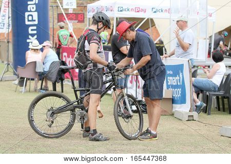 Official Clocking Rider's Time At Finish Line At Mountain Bike Race