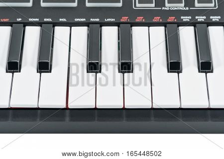 Keys black electric piano with control buttons, close-up