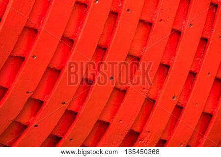 Red rows of painted wooden side of a fishermen boat