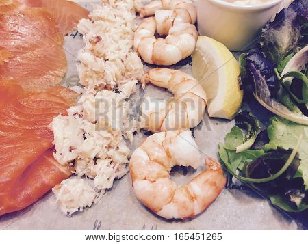 Mixed seafood platter served on a slate - filter applied