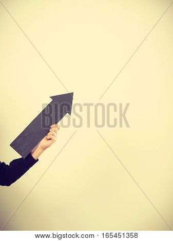 Man Holding Black Arrow Pointing Right