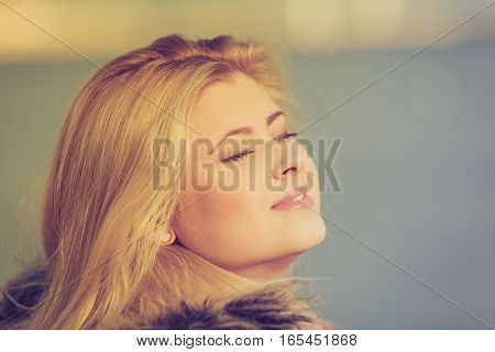Woman Relaxing Outside On Cold Day