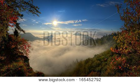 Panorama of misty autumn Pieniny mountains in sunrise light Poland