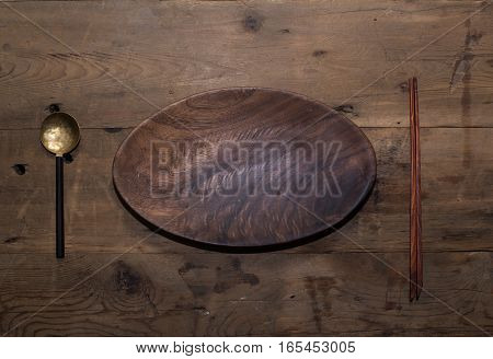 kitchen utensils and silver on a wooden background