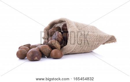 roasted chestnuts in canvas bag on white background.
