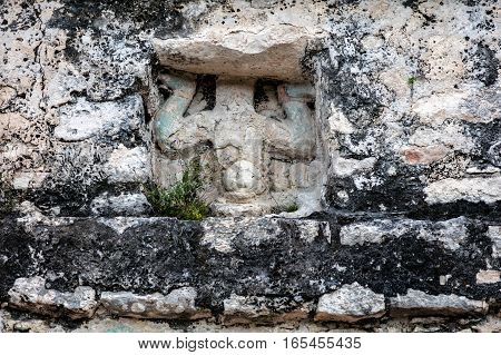 Ancient Mayan carving of the 'diving god' over the door of the small temple building which crowns the Coba pyramid in Quintana Roo Yucatan Mexico.