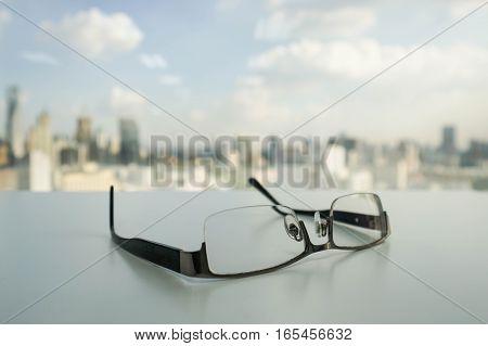 men black glasses on the office desk